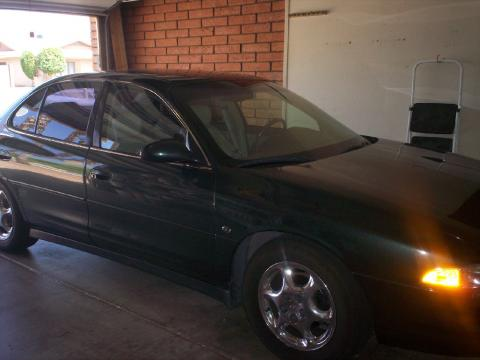 Forest Green Metallic 1999 Oldsmobile Intrigue GL with Neutral interior 1999