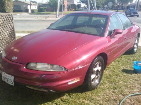 1995 Oldsmobile Aurora 4.0 in Dark Cherry Red Metallic