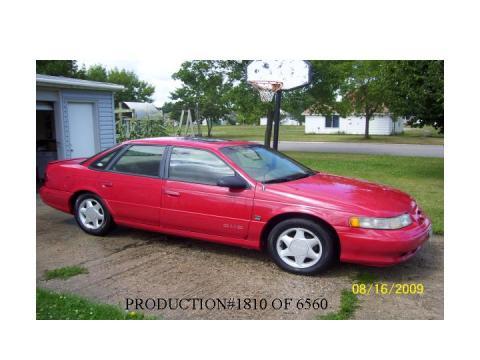 1995 Ford Taurus SHO in Vermillion Red