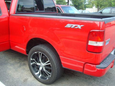 2004 Ford F150 STX SuperCab in Bright Red